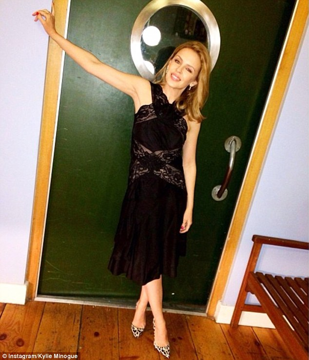 Kylie Minogue shows she's still got it as she shares snap of herself in colourful stiletto heels