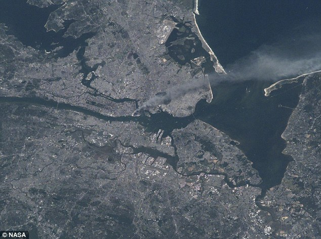Astronaut relives emotional moment he watched 9/11 unfold from space and played bugle tribute to his friend who was killed in the terror attack